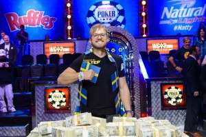 2014 WSOP Champion Martin Jacobson with his bracelet and $10 million in cash