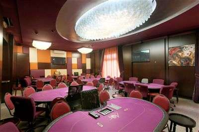 The elegant cash-game poker room at the Aviation Club.