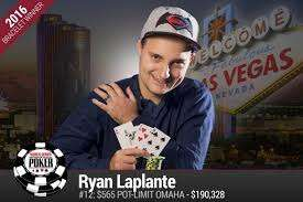 Ryan Laplante poses with his winning hand on Saturday after winning his first WSOP title. (Photo source: WSOP)