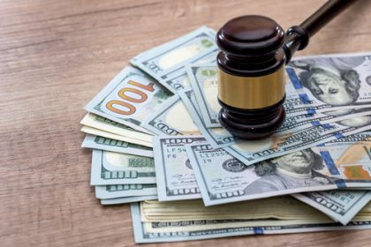 gavel with usa dollar on desk