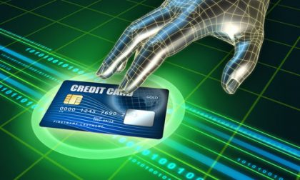 Hacker's hand trying to steal a credit card