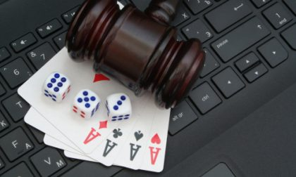 Judge gavel aces and dices on computer keyboard
