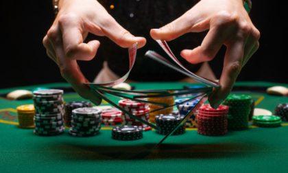 croupier shuffles poker cards